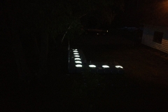 1000 Islands Docks Ltd. - Eastern Ontario - Residetial Floating Modular Dock Installation at Night Showing LED Lights Image