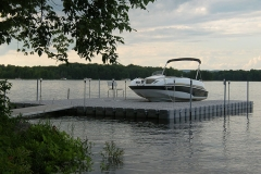 1000 Islands Docks Ltd. - Eastern Ontario - Residetial Floating Modular Dock Installation with Boat at Sunset Image